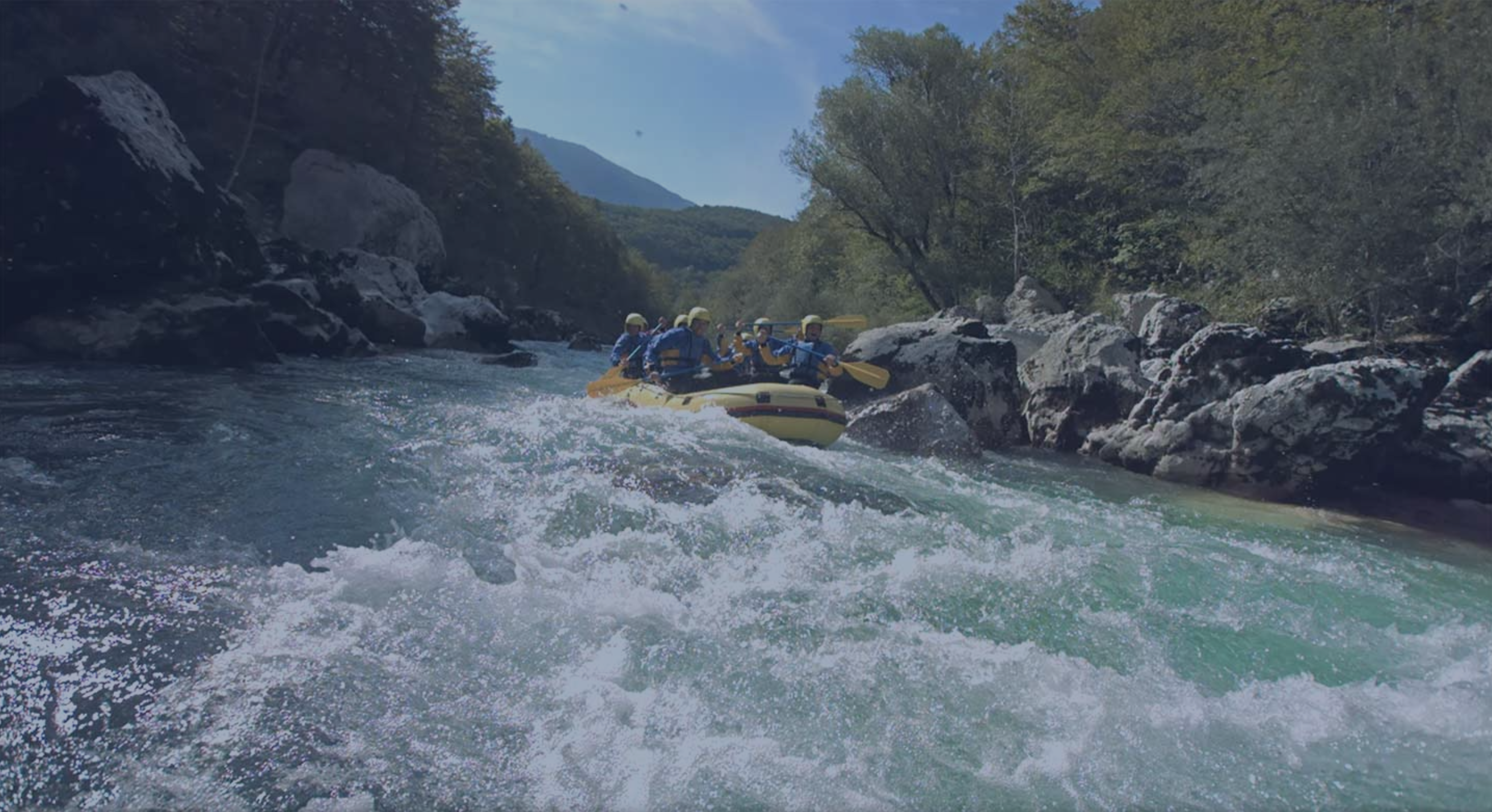 A group of white water rafters in a boat.